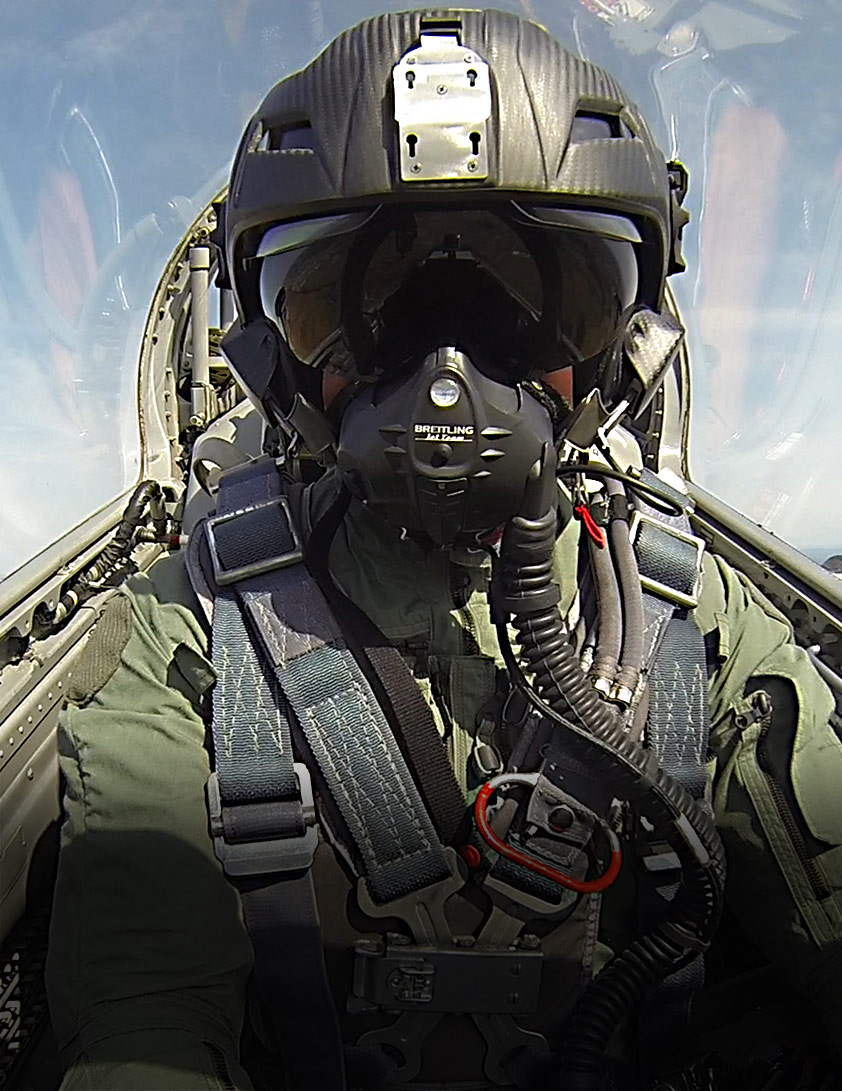Jet fighter in action with H-CMF flight helmet